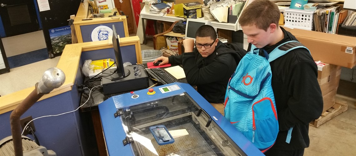 Crosby STEAM Students using Laser Engraver