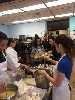 Culinary Arts Students serving Potato, Carrot, and Fennel Soup