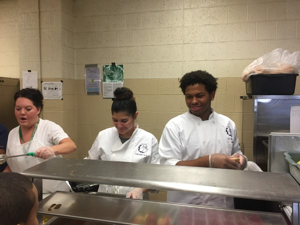 Crosby Culinary Arts students serve Thanksgiving meal along with Wallace staff