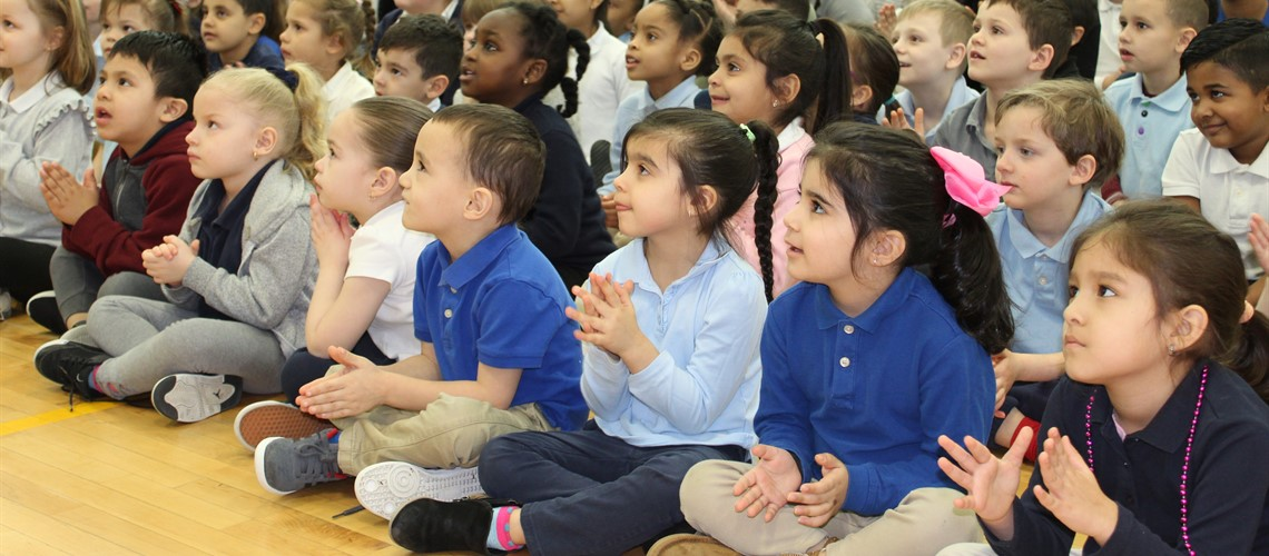 Carrington Elementary School students attend school assembly.