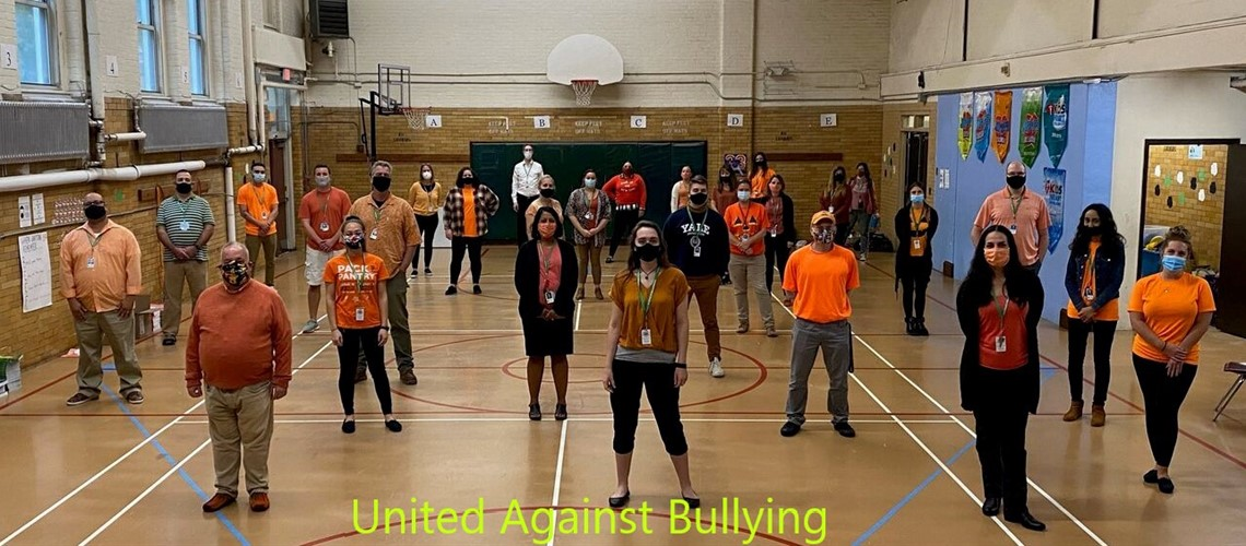 The Staff at Bunker Hill wear orange to take a stand against bullying.